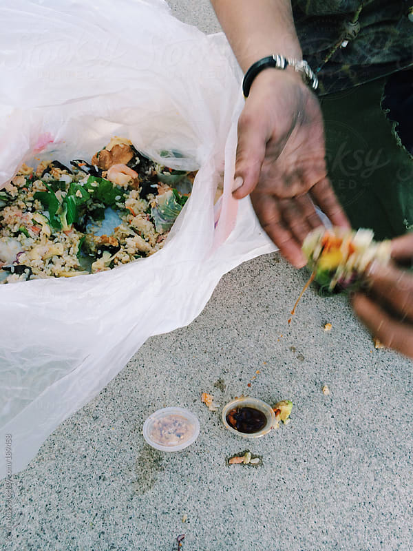 Woman Eating Dumpster Sushi by Kevin Russ for Stocksy United