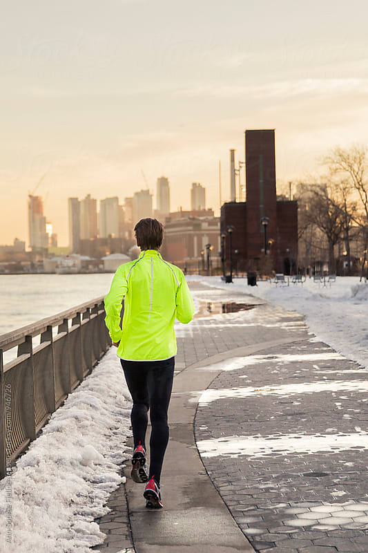 Male runner running along East River by Ann-Sophie Fjelloe-Jensen for Stocksy United