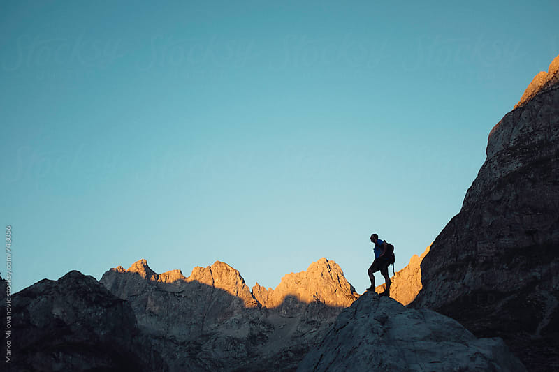 Mountaineer standing alone at the high mountains by Marko Milovanović for Stocksy United