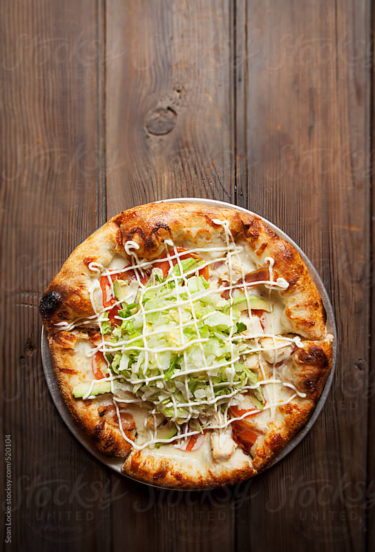 Pizza: Overhead Of Bacon Lettuce Tomato Pie On Rustic Table by Sean Locke for Stocksy United