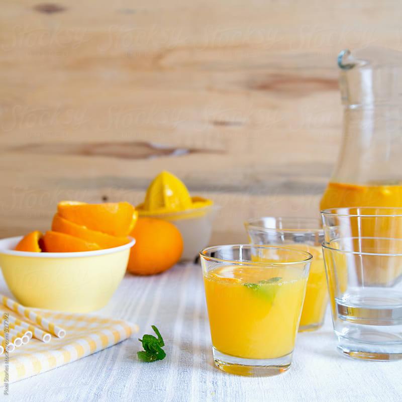 Drinks: making orange juice by Pixel Stories for Stocksy United