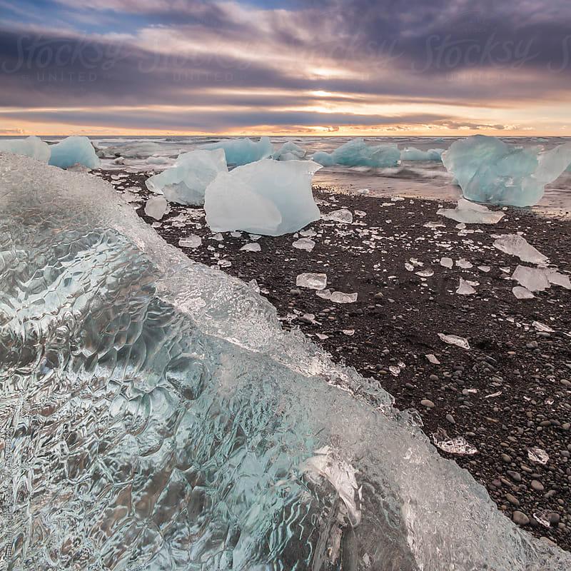 Icebergs on Jokulsarlon Beach at sunrise by Marilar Irastorza for Stocksy United