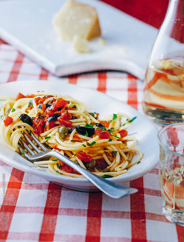 Spaghetti with sauce, olives and capers by J.R. PHOTOGRAPHY for Stocksy United