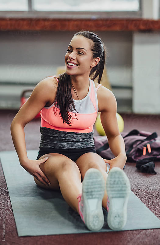 Sporty Woman Sitting on the Floor after the Workout by Lumina for Stocksy United