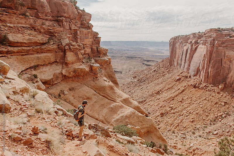 Greg in Moab by Sidney Morgan for Stocksy United
