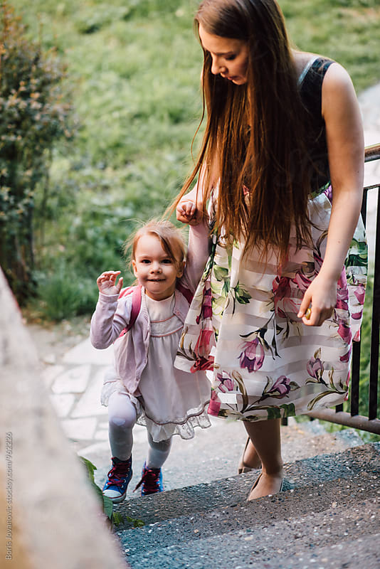 Mother walking downtown with her daughter by Boris Jovanovic for Stocksy United