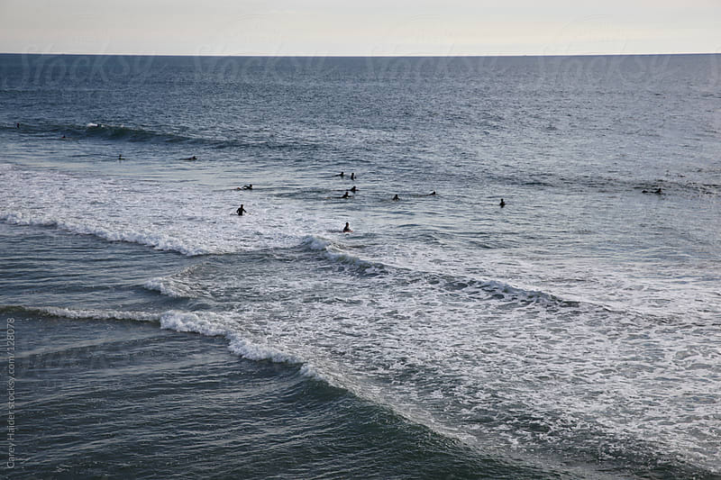 Surfers Surfing In The Ocean by Carey Haider for Stocksy United