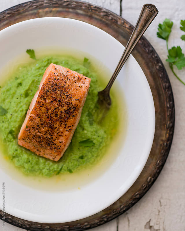 Close-up of delicious homemade fish steak with pesto by Trent Lanz for Stocksy United