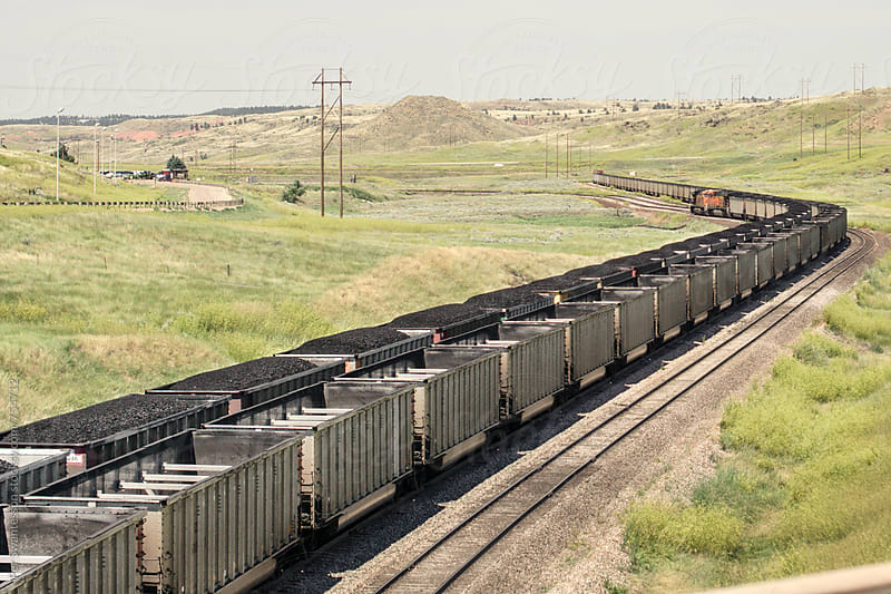 Long train transporting coal from mine by Per Swantesson for Stocksy United