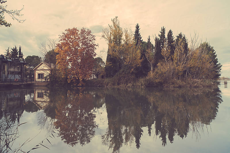 autumn landscape with house reflected in the lake by Javier Pardina for Stocksy United