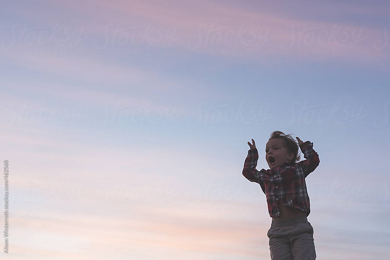 A Little Boy Yells Into the Sunset by Alison Winterroth for Stocksy United