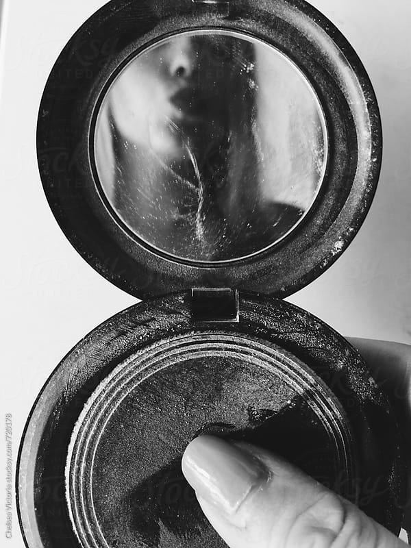 Series of self portraits of a woman making faces in a compact mirror. by Chelsea Victoria for Stocksy United