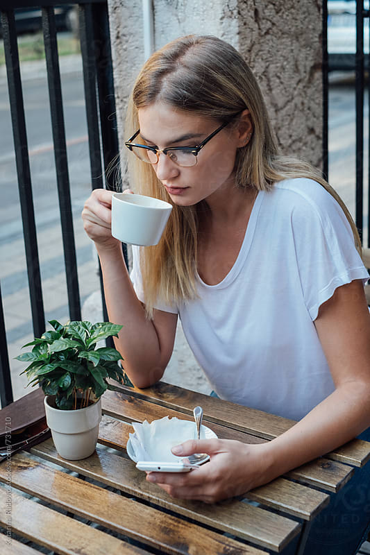 Pretty Blond Woman Having Coffee by Katarina Radovic for Stocksy United