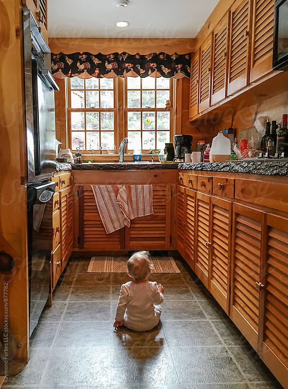 Toddler exploring Kitchen by Raymond Forbes LLC for Stocksy United