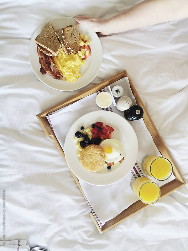 Breakfast in bed by Melanie Riccardi for Stocksy United