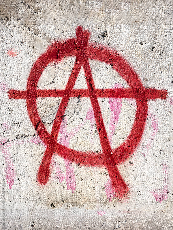Anarcho-punk circle-A symbol on wall by Pixel Stories for Stocksy United