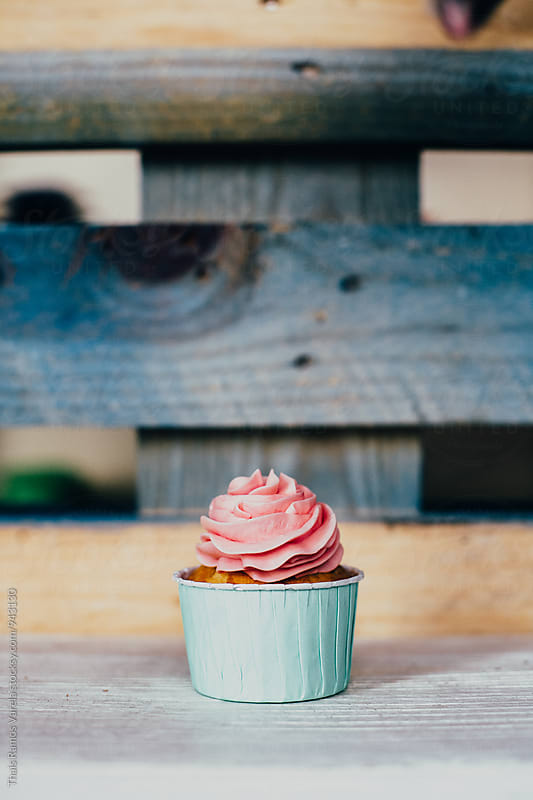 pink cupcake by Thais Ramos Varela for Stocksy United