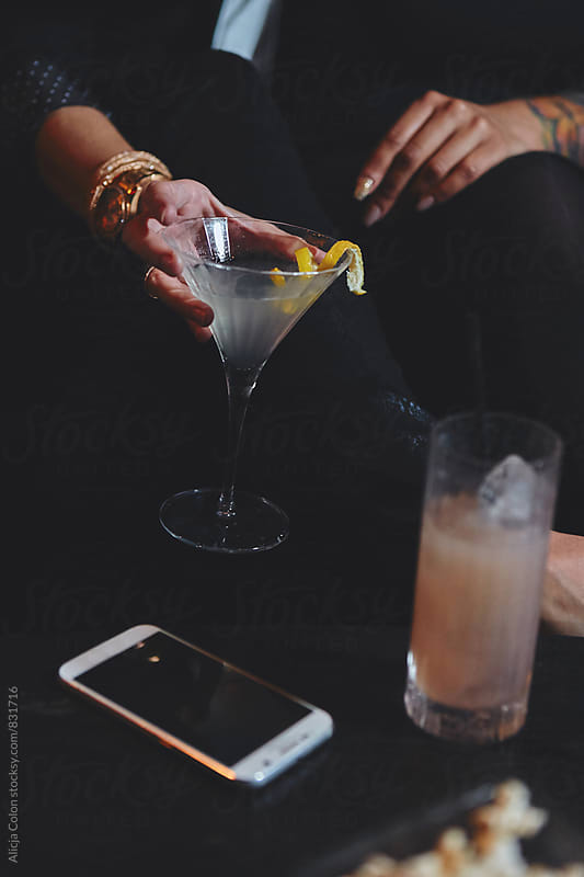 Hand holding a lemon martini  by Alicja Colon for Stocksy United