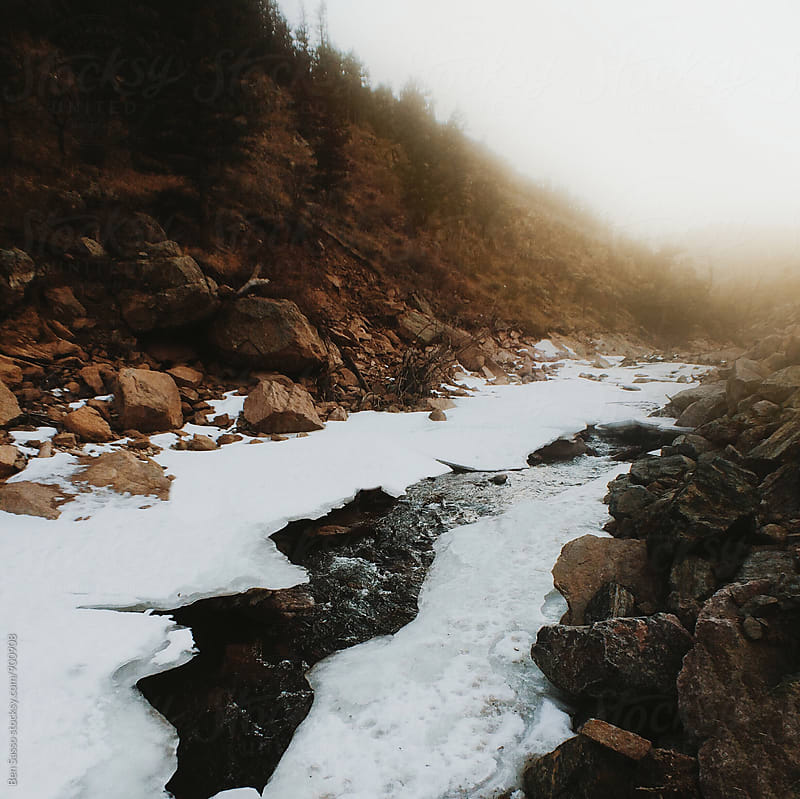 Icy river in Colorado by Ben Sasso for Stocksy United