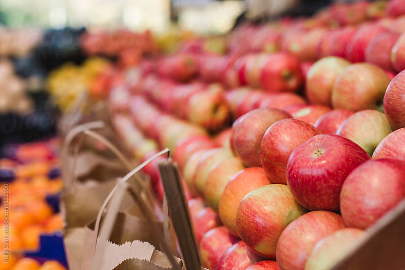 Apples for sale at a market. by Holly Clark for Stocksy United
