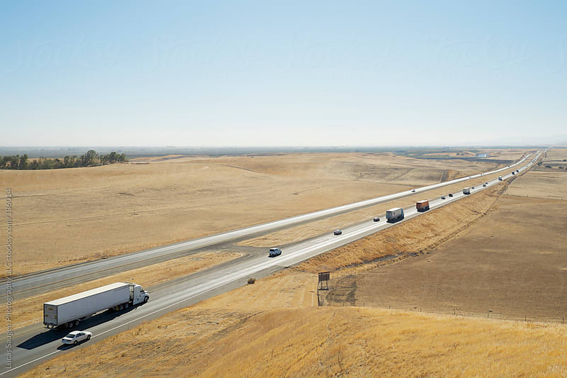 Long line of cars on a California freeway. by Lucas Saugen for Stocksy United