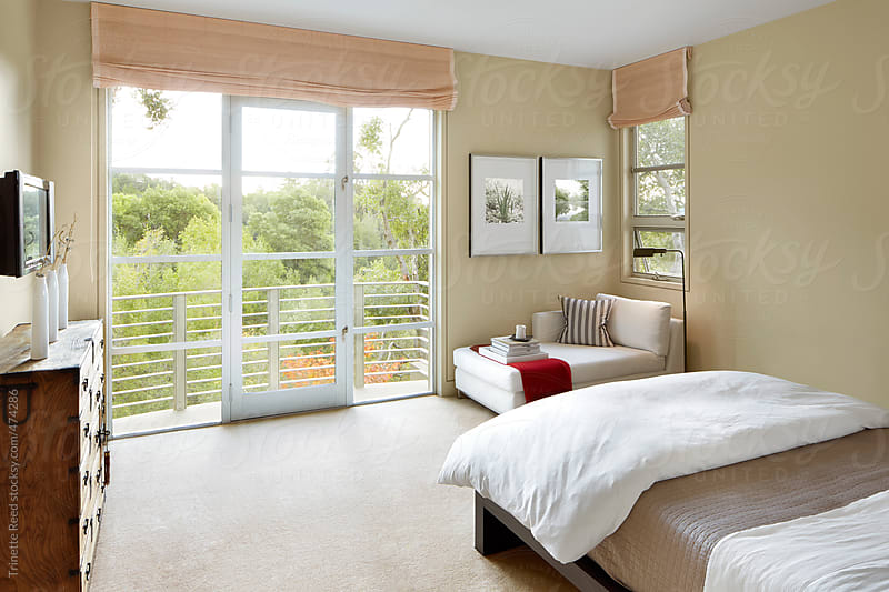 Bedroom of modern design luxury home by Trinette Reed for Stocksy United
