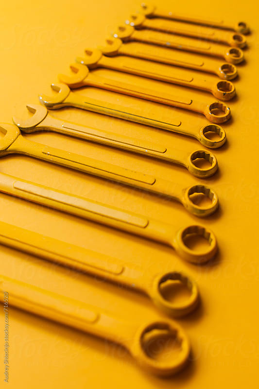 Yellow wrench set on yellow background. by Audrey Shtecinjo for Stocksy United