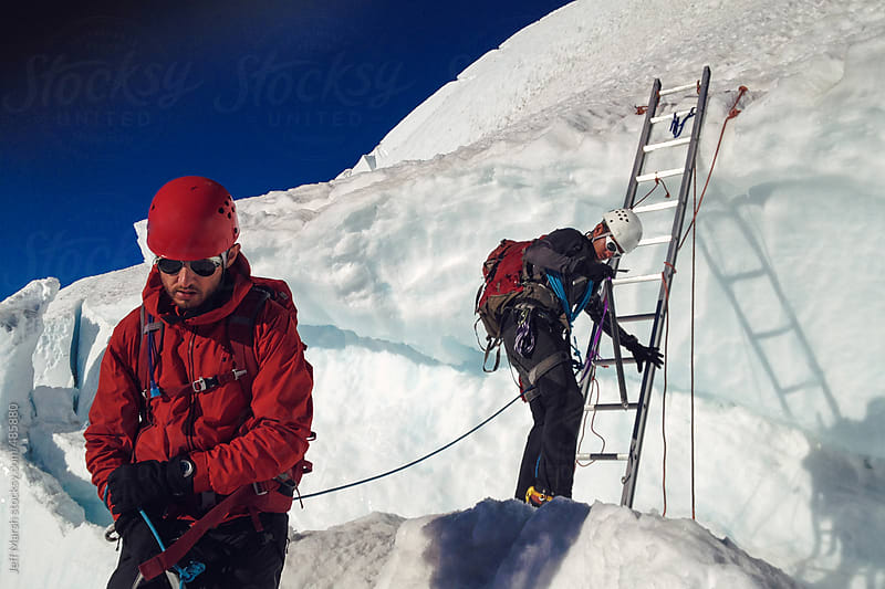 Climbers Descending Mountain by Jeff Marsh for Stocksy United