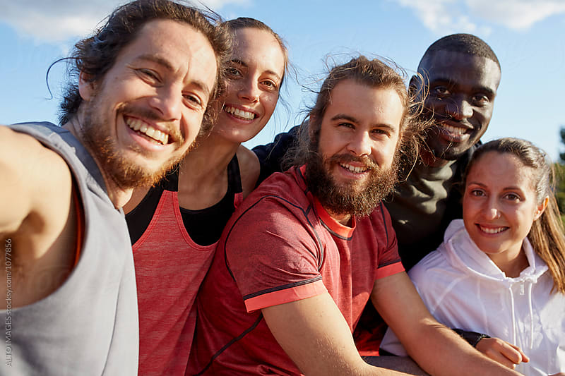 Smiling Multiethnic Friends After Workout Outdoors by ALTO IMAGES for Stocksy United