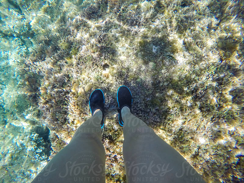 Woman legs on the seabed by ACALU Studio for Stocksy United