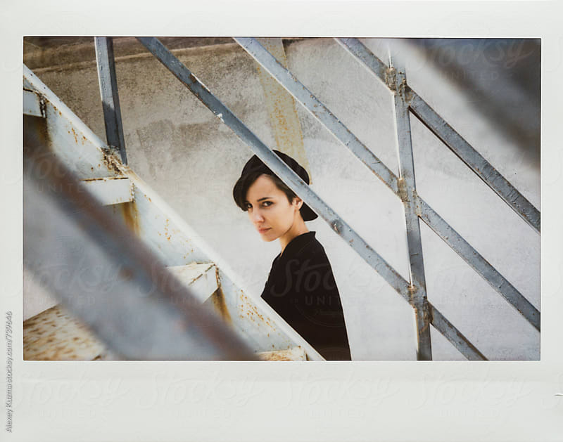 instant photo with tomboy by Alexey Kuzma for Stocksy United