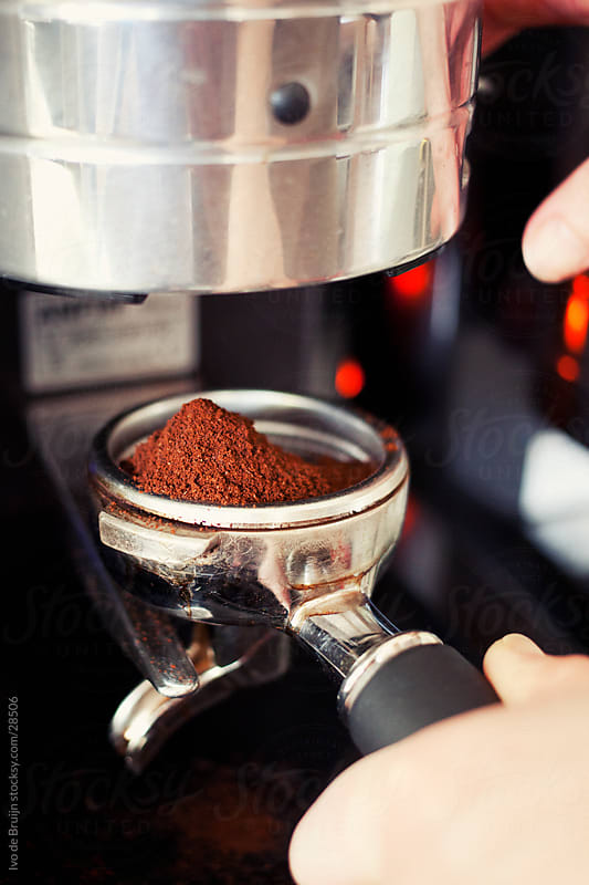 Classis espresso piston filled by freshly grinded coffee  by Ivo de Bruijn for Stocksy United
