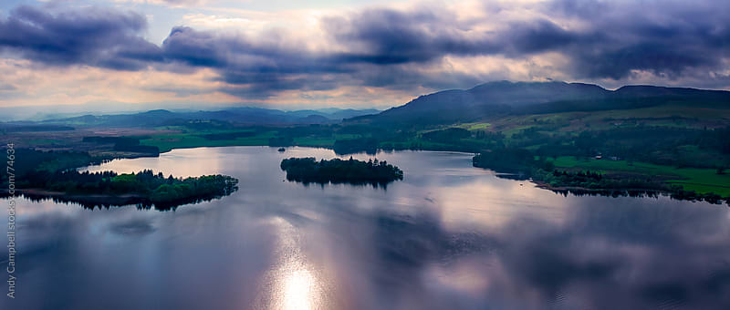 Aerial panoramic landscape view of a Scottish loch by Andy Campbell for Stocksy United