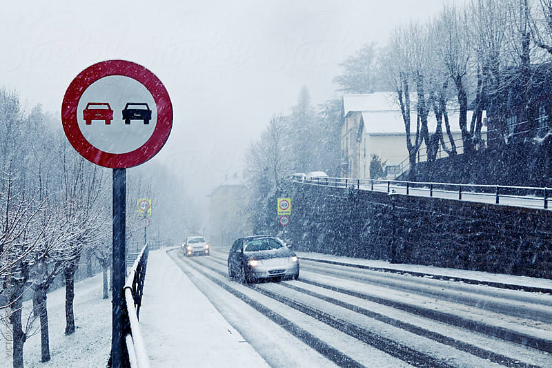 Overtake Forbidden Sign in a Snowy Road by VICTOR TORRES for Stocksy United
