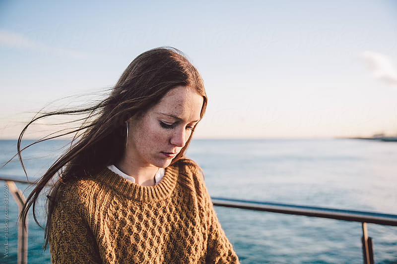Portrait of a beautiful freckled woman by the seaside by Vera Lair for Stocksy United