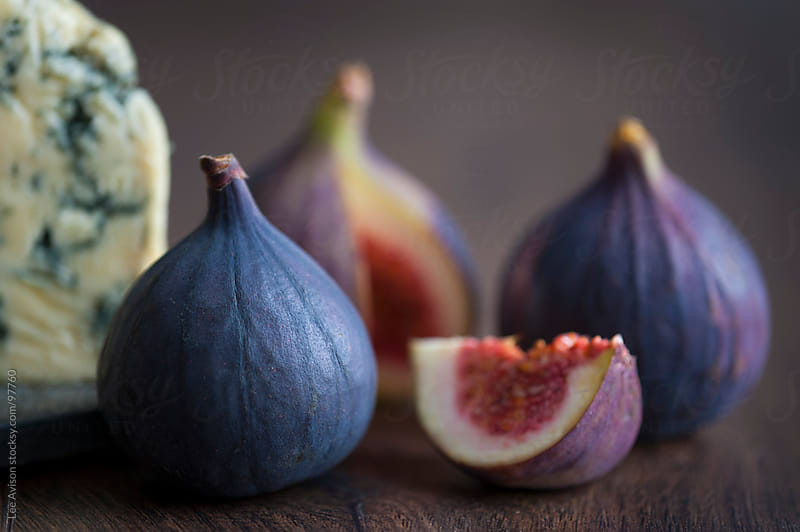fresh ripe figs and stilton cheese by Lee Avison for Stocksy United