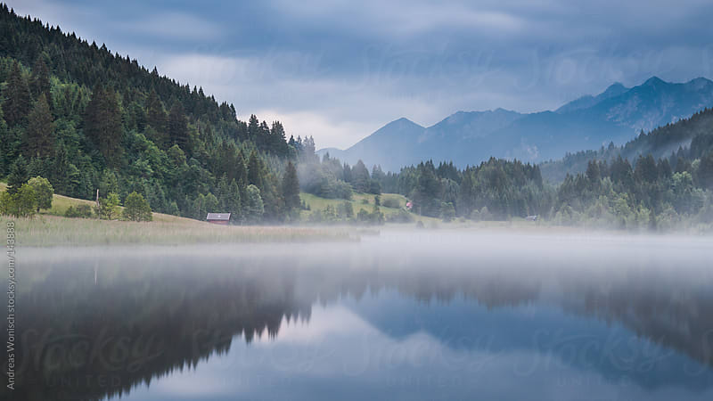 Panoramic view after sunset at Bavarian Lake by Andreas Wonisch for Stocksy United