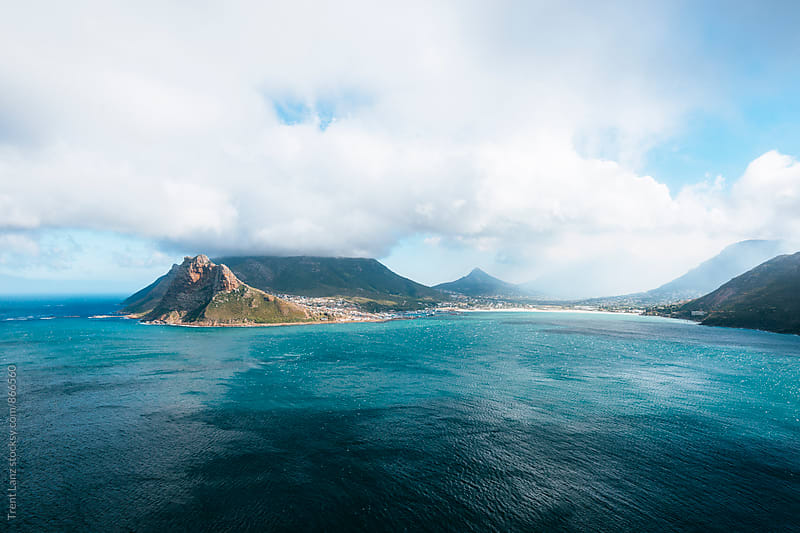 Picturesque seascape of island volcano in the blue sea by Trent Lanz for Stocksy United