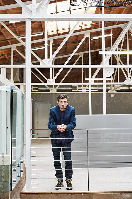 Portrait of millennial at work in modern design office by Trinette Reed for Stocksy United