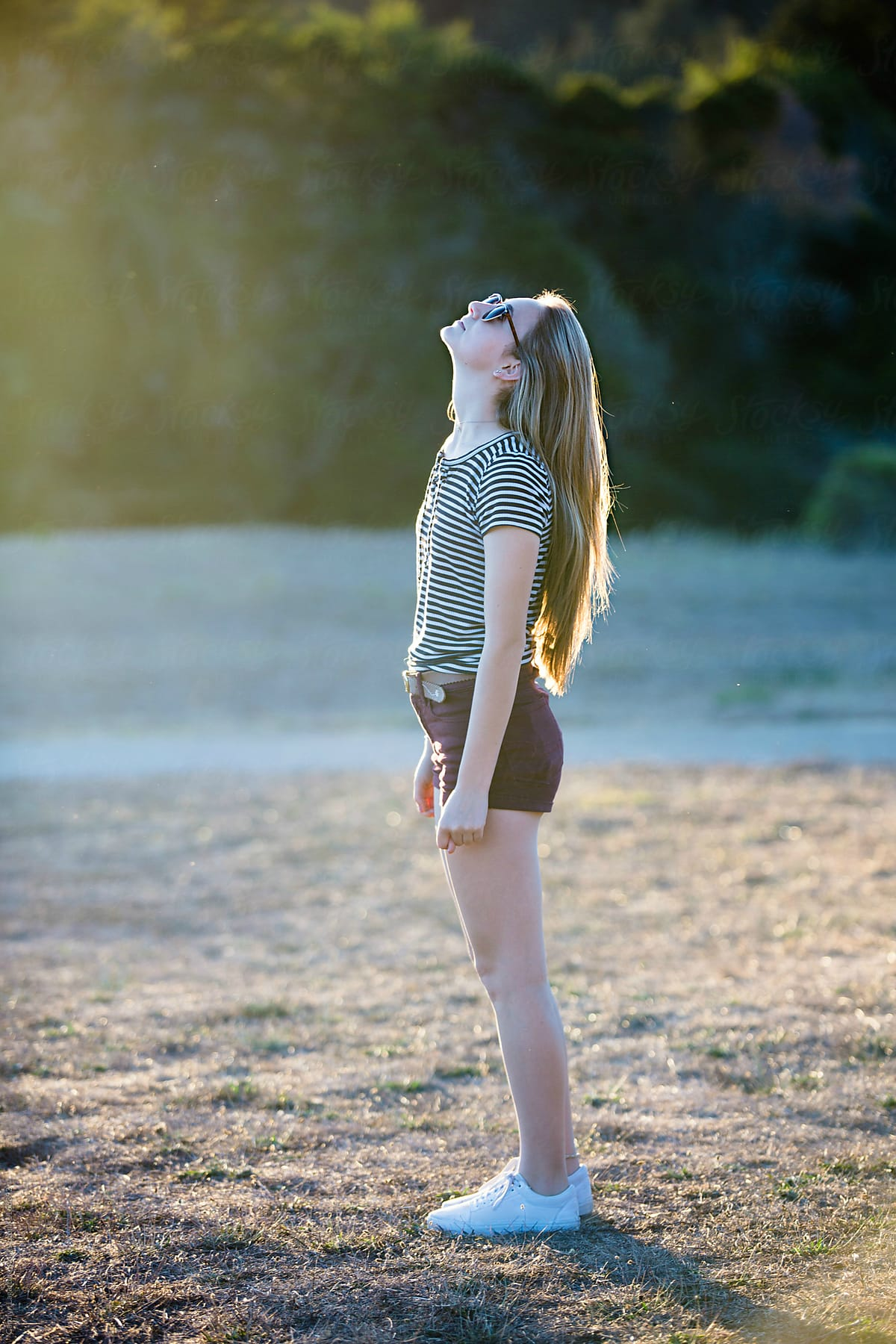 Teenage Girl With Long Blonde Hair Looking Up At The Sky By Carolyn Lagattuta Stocksy United