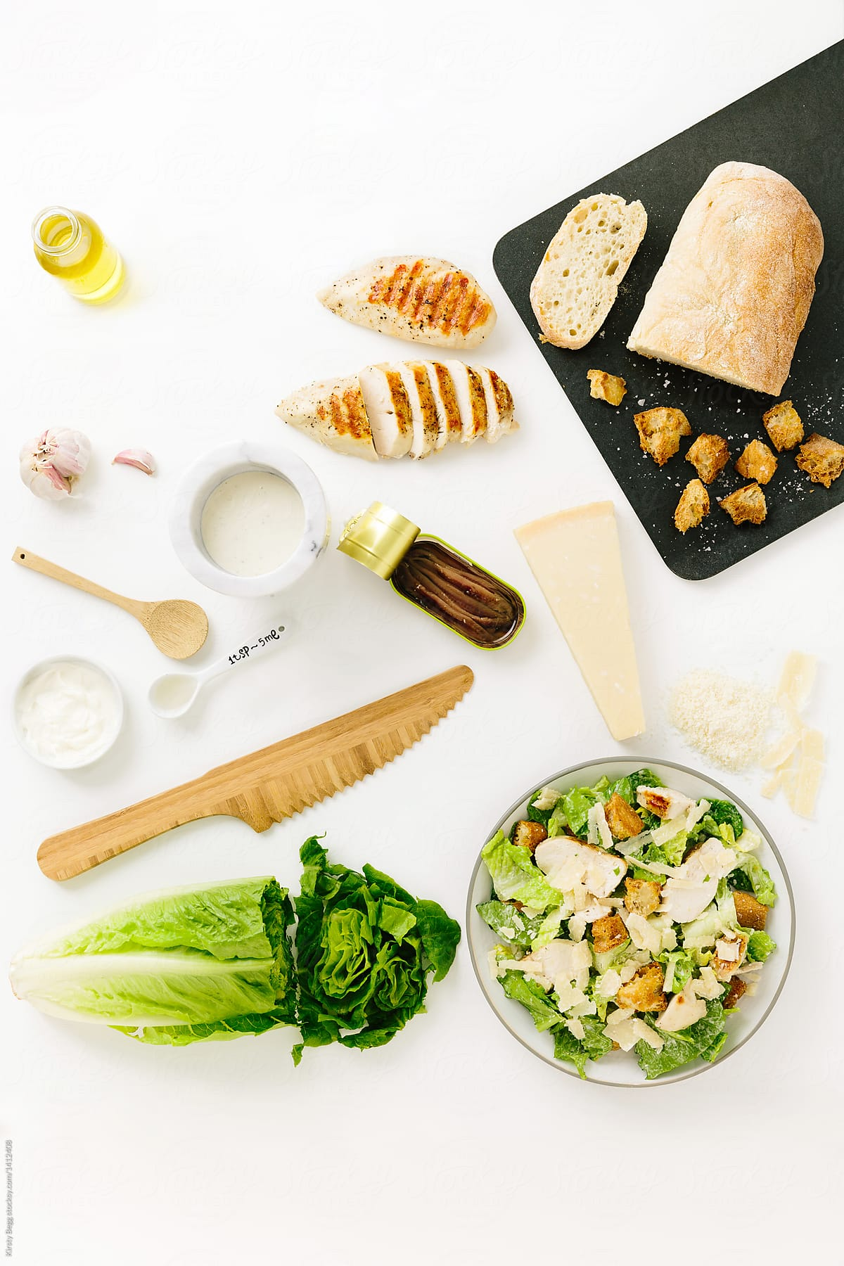 recipe layout for chicken caesar salad with ingredients stocksy united