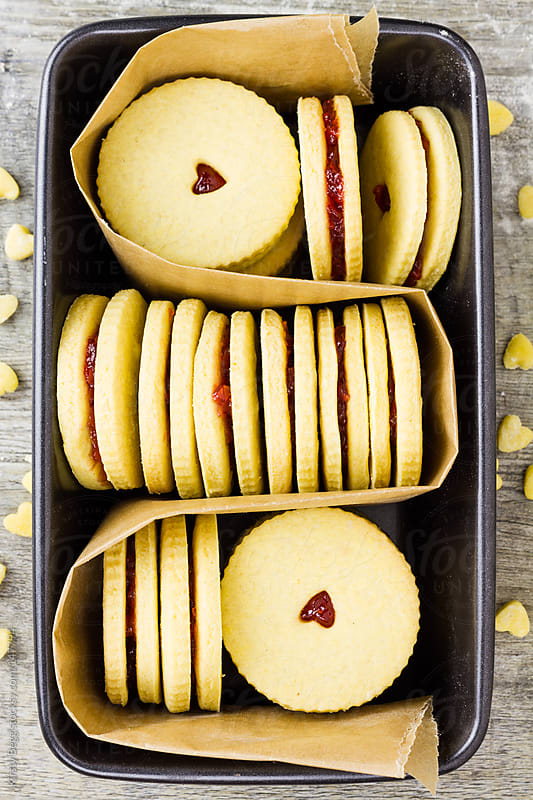 Jammie Dodgers in baking tin by Kirsty Begg for Stocksy United