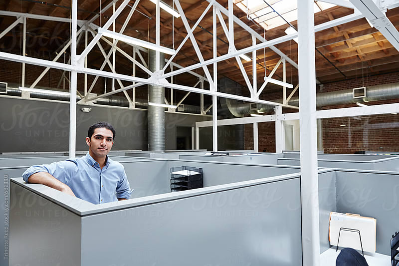 Portrait of millennial Indian businessman at work by Trinette Reed for Stocksy United