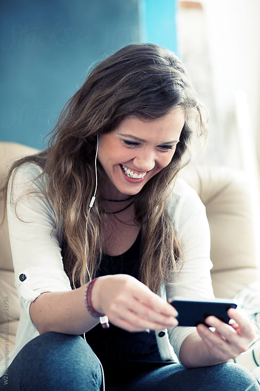 Smiling woman on a smartphone videochat. by W2 Photography for Stocksy United