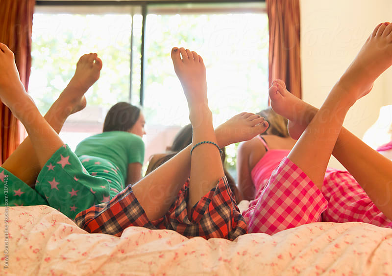 three tweens having a sleep-over by Tanya Constantine for Stocksy United
