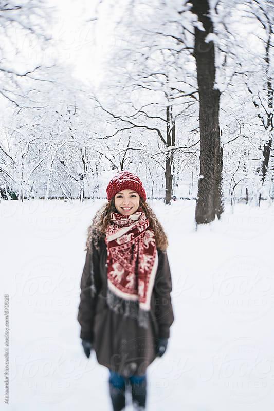 Beautiful woman enjoying winter in the park by Aleksandar Novoselski for Stocksy United