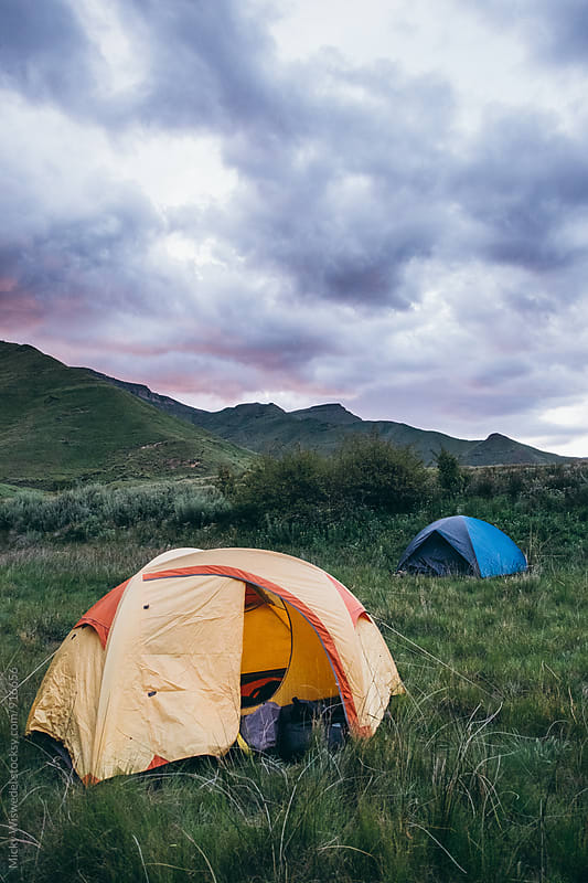 camping tents in the mountainous Lesotho highlands at dusk by Micky Wiswedel for Stocksy United