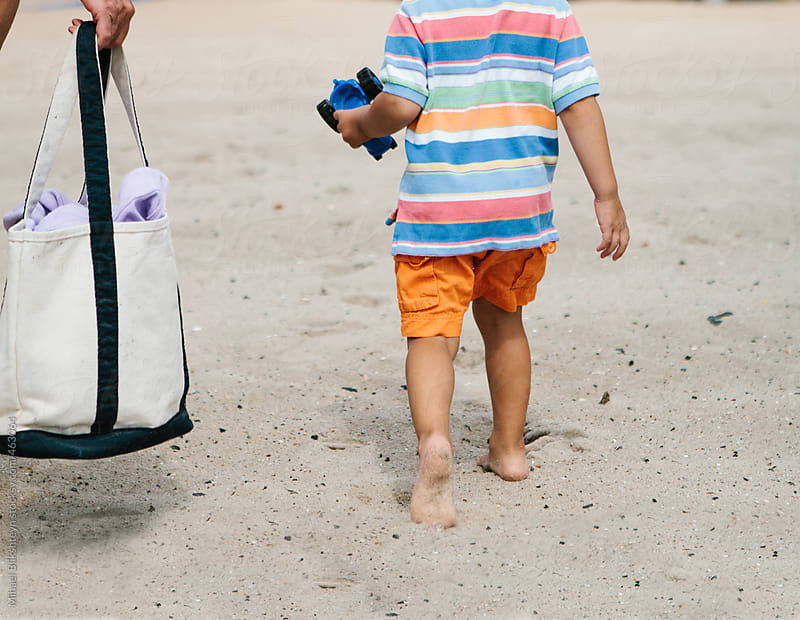 Mother with beach bag and towel and son walking to the beach in the summer by Mihael Blikshteyn for Stocksy United