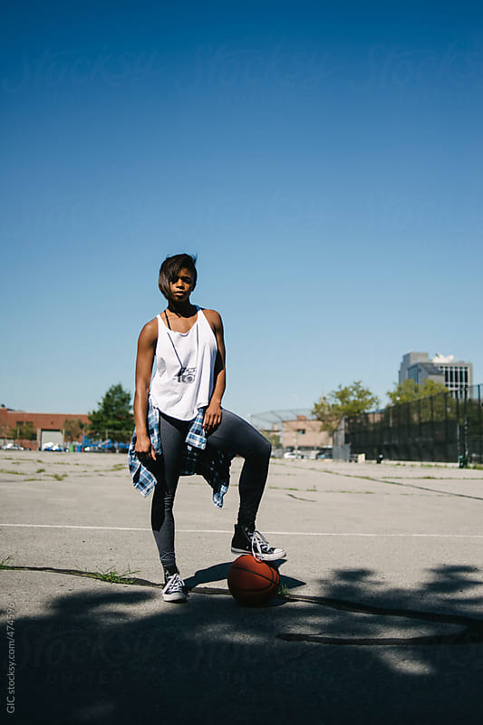 Young black woman portrait holding a basketball by GIC for Stocksy United
