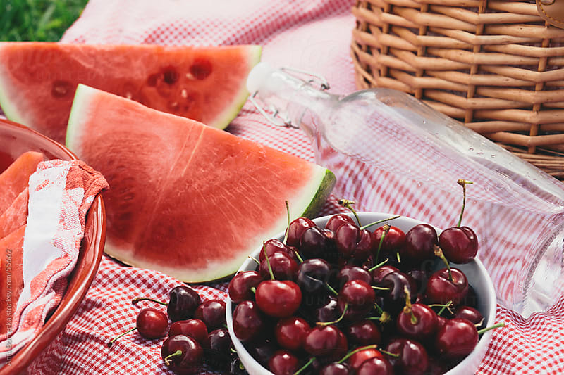 Picnic of cherries, watermelon and fruit by Ania Boniecka for Stocksy United